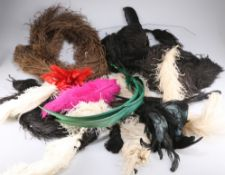 A box of assorted coloured and natural ostrich and other millinery feathers