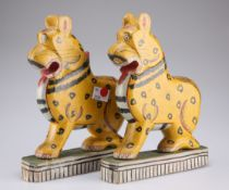 A pair of Odisha East Indian hand carved and painted figures of leopard on green painted rectangular