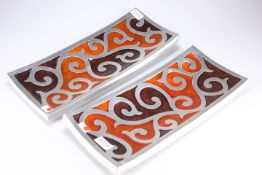 A pair of mid-20th Century Scandinavian aluminium, brown and orange coloured enamel decorated trays