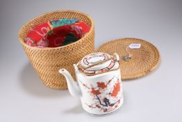 A 20th century Chinese Imari porcelain teapot, base unmarked, contained within a woven basket. 17cm