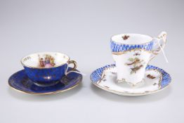 A Continental style cup and saucer decorated with butterflies and birds together with a Limoges