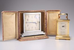 An early 20thCentury Indian 8 day mantel clock, the chrome case engraved to A.A. Hamilton from