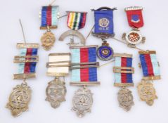 A group of Masonic medals with ribbons,