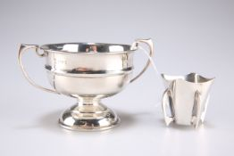 A small silver presentation bowl and vase