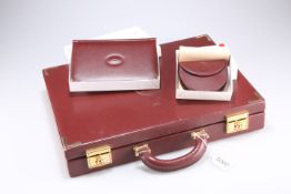 A Cartier briefcase together with a boxed coin purse and boxed address book