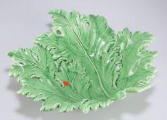 A Continental green glazed pottery leaf dish, 32cm