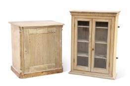 A Victorian pine wall hanging cabinet, fitted with a pair of glazed doors; together with a 19th Cent