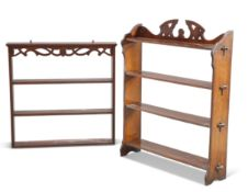An early 20th century oak open bookcase; together with a Georgian style small hanging plate rack. (