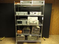 Lot to Include Entire Rack: (2) Tandberg MPEG-2 TT1108 Decoder, (1) Intercontinental Microwave