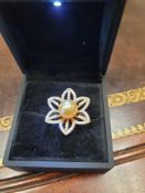 14 k yellow gold with a south seal pearl and diamonds