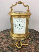 "19th c Scottish retailed oval ornate carriage clock, dial marked ""Leith Street Edinburgh"". 13cm x 11"