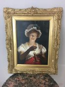 19th c oil on canvas of lady and a candle, unsigned in ornate gilt mirror, tear to the top right of