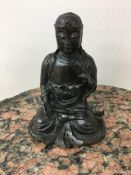 19th c Bronze chinese figure of a meditating scholar sat in the lotus position lead filled at a late