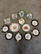mixed lot of ornate plates to include still life of fruit.