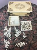 Meiji period carved ivory box and puzzle.