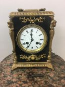 19th c French ebonised and gilt mantle clock, striking on bell. 22cm x 18cm x 13cm.