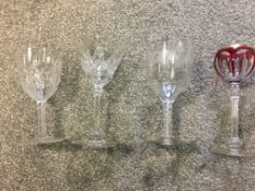 Four 19th c wine glasses, to include ribbon twist wine and grape engraved example, red and gilded ex