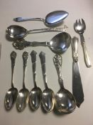 Large silver continental serving spoons in Nouveau