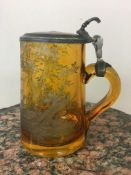 """19th c Amber and pewter glass stein, with engraving of dogs chasing fowl and the letters """"A M""""to the"""