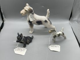 Three Terrier Dog Figurines. All in great ondition