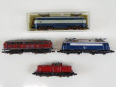 A group of unboxed German and Italian Outline N Gauge diesel and electric locomotives by