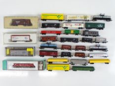 A quantity of N Gauge American Outline freight cars - mostly unboxed - by various manufacturers -