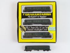 A GRAHAM FARISH N Gauge Class 101 3-car DMU in BR green together with an additional unboxed centre