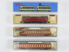 A group of N Gauge Japanese Outline items by KATO to include a 2-car diesel railcar, a 2-car