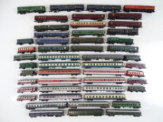A large quantity of unboxed European Outline N Gauge passenger coaches by various manufacturers -
