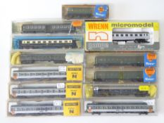 A group of N Gauge French and Belgian Outline passenger coaches by various manufacturers - G in F/