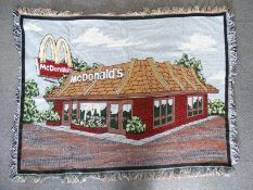 """MCDONALDS: A woven throw / blanket with image of McDonald's restaurant - 54"""" x 39"""" - made in USA"""