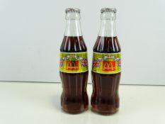 MCDONALDS / COCA-COLA - A pair of 1993 filled Coca-Cola bottles