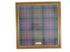 MCDONALDS: A framed and glazed piece of McDonald Tartan (Ancient)