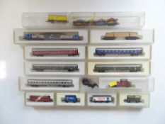 A group of mostly boxed Z gauge rolling stock and a diesel loco by MARKLIN - G/VG in F/G boxes (14)
