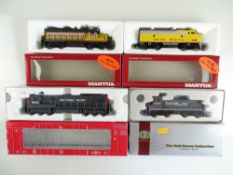 A group of American Outline diesel locomotives by MANTUA, CON-COR and ATLAS - VG in G boxes (4)