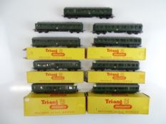 A quantity of TRI-ANG TT Gauge Class 104 DMU power cars, trailer cars and centre cars - some boxed -