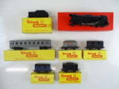 A group of TRI-ANG TT Gauge Continental Outline rolling stock to include a French Pacific steam