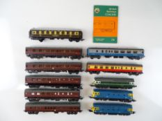 A group of HO Scale British Outline diesel locomotives and coaches by LIMA - comprising 3 x Class 33