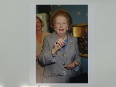 MARGARET THATCHER - A signed 10x8 colour photograph (candid shot with handbag) - this item has