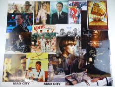 A large quantity of signed photographs - different sizes - largest being 16x12 - all are stars of TV
