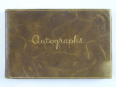 A vintage autograph book containing a NOEL COWARD autograph in addition to many other unknown