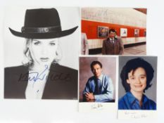 A group of four signed items comprising: KIM WILDE (singer) 10 x 8 black/white photograph, BOB
