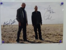 BREAKING BAD: A pair of signed photographs comprising: A 16x12 signed by BRYAN CRANSTON and AARON