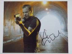 24: KIEFER SUTHERLAND - A signed colour 10x8 action photograph - this has been independently checked