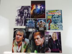 DR WHO: A selection of photographs comprising: (16x12, 12x8 (2), 10x8) together with a magazine