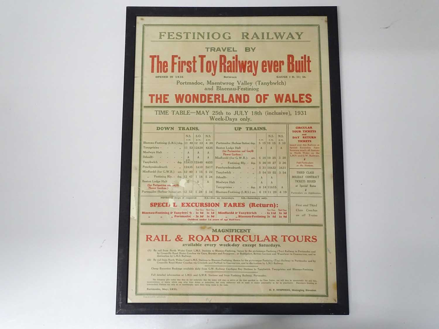 """A framed and glazed Festiniog Railway timetable (17"""" x 25"""" in a 19"""" x 26.5"""" frame) from May - July"""