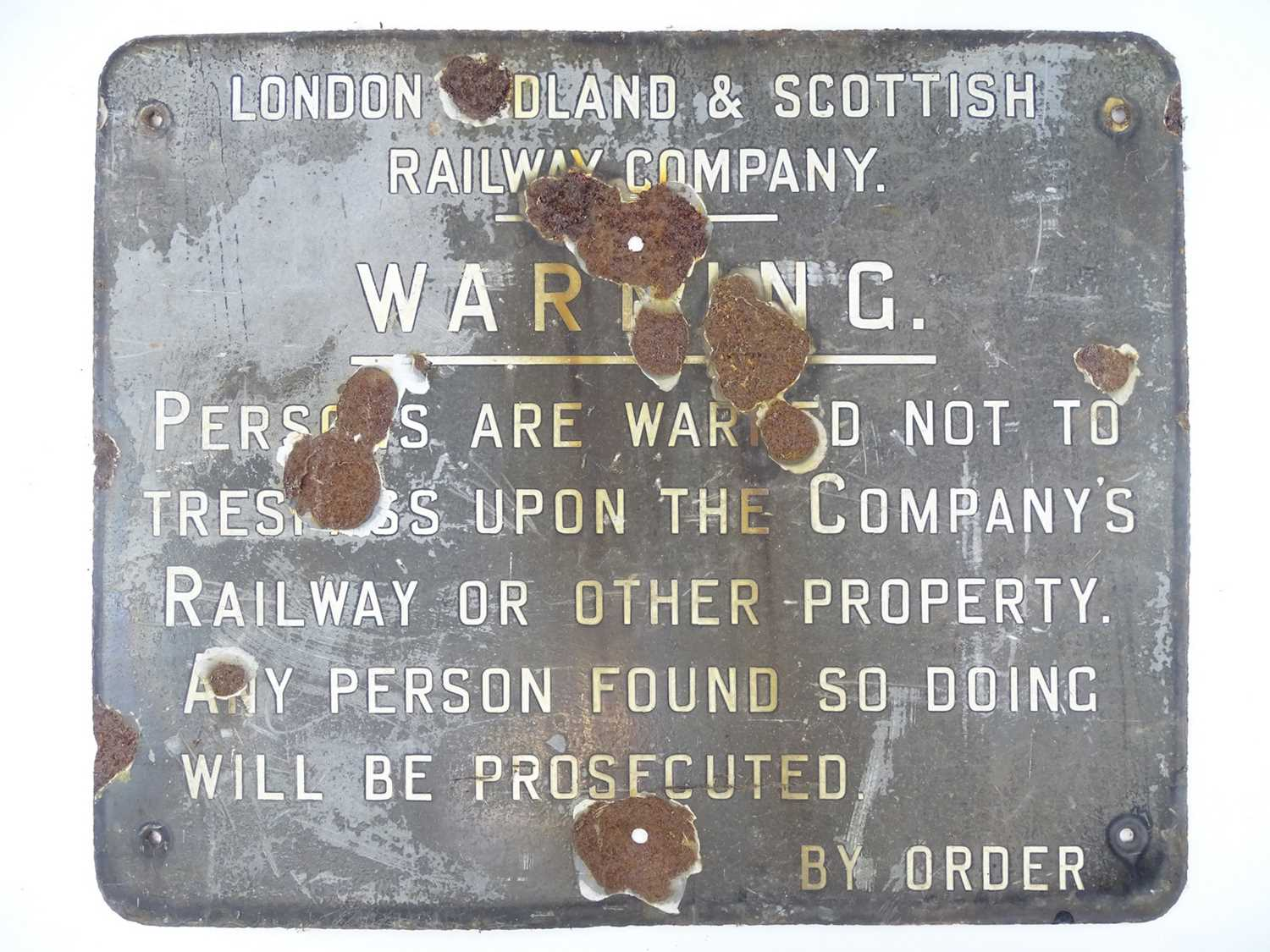 """An enamel sign for the LMS Railway - warning against trespass - some significant wear (22"""" x 18"""")"""