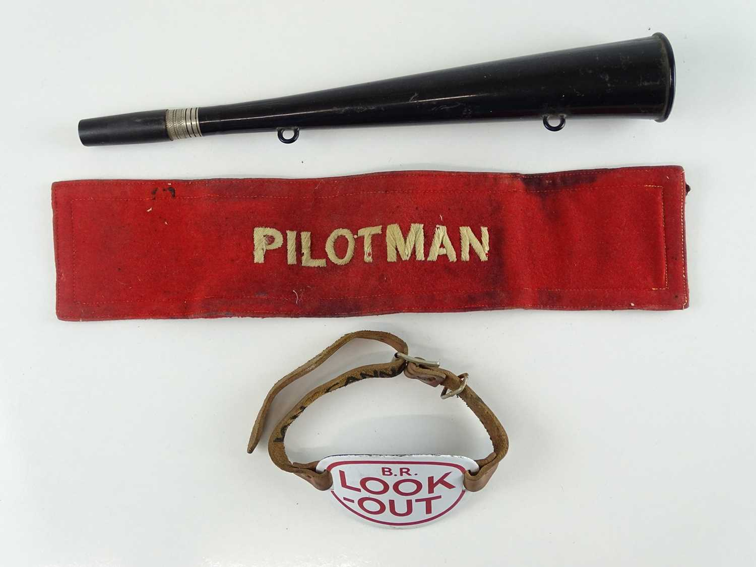 A group of British Rail ephemera comprising: An enamel 'Look Out' armbadge with strap and warning