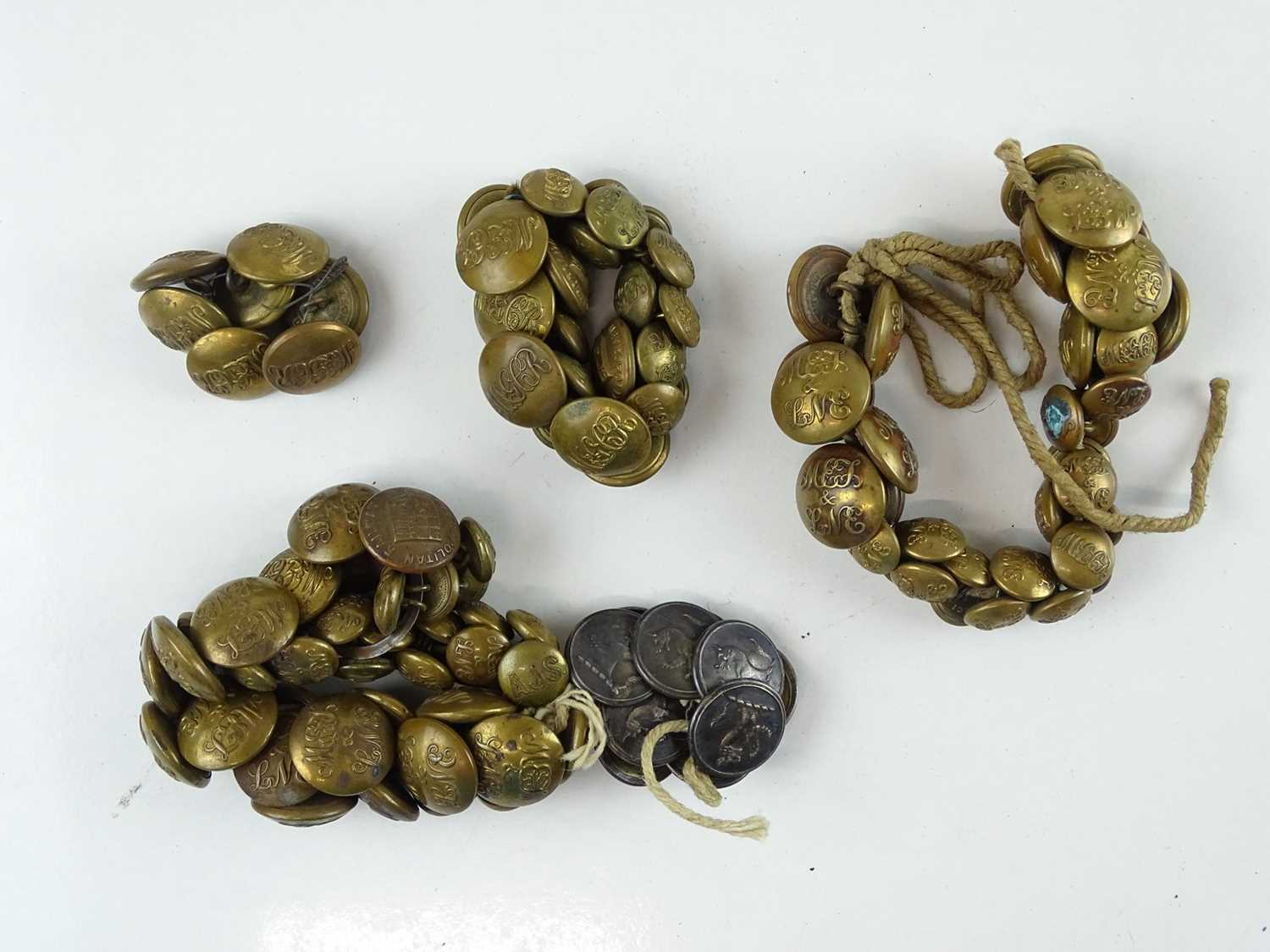 A quantity of brass uniform buttons - all appear to be for the Metropolitan Railway and associated