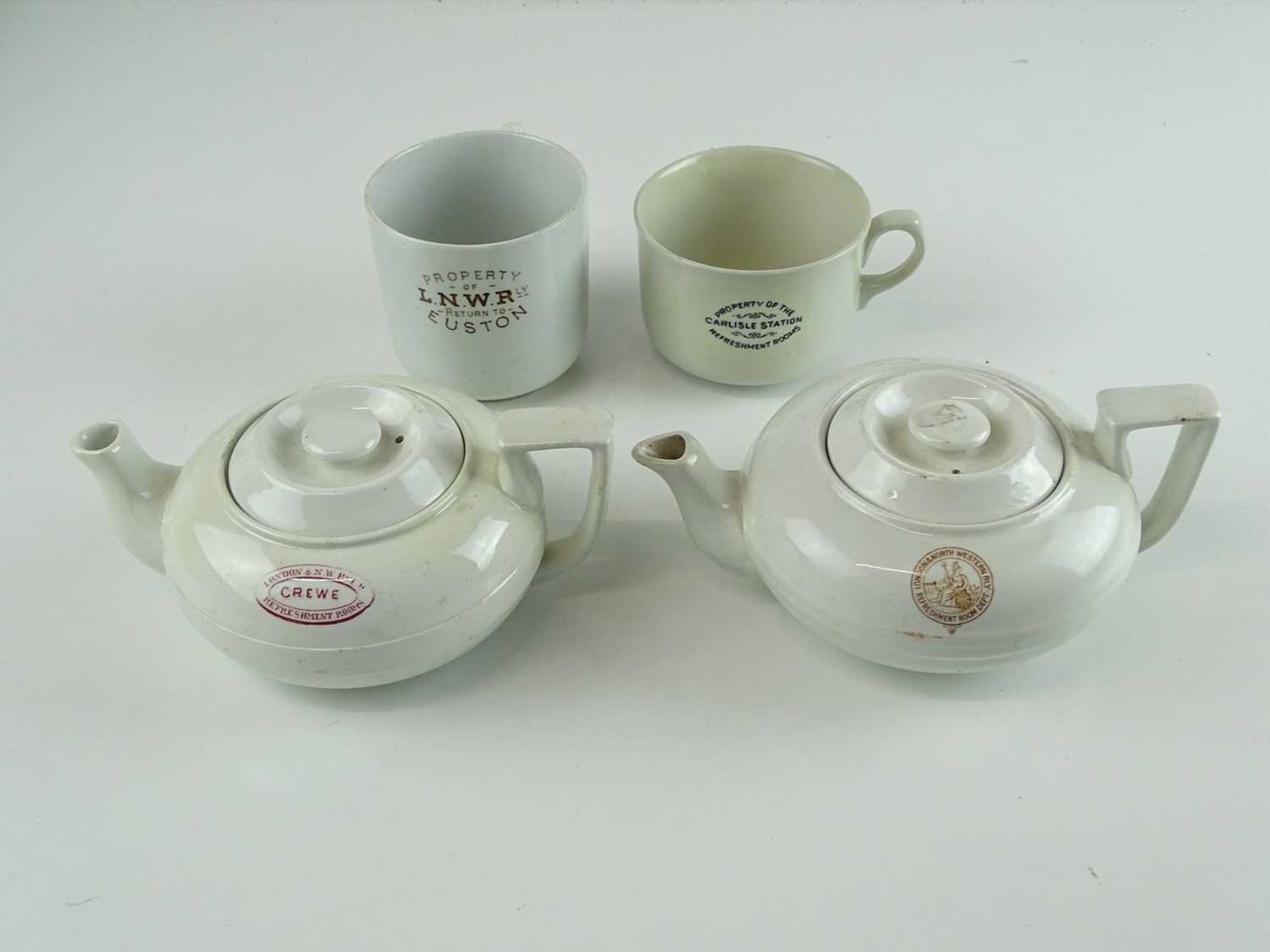 A group of early railway crockery items comprising 2 x L&NWR teapots (one marked Crewe), an LNWR